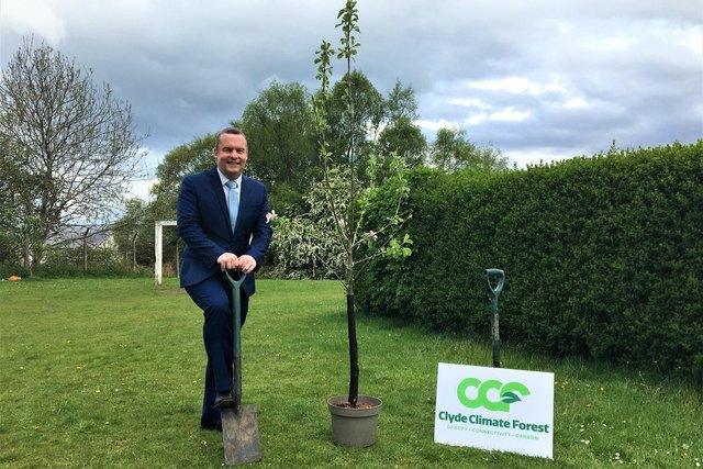 Councillor Andrew Polson, joint leader of East Dunbartonshire Council, is ready to start planting